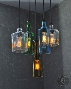 Rustic Colored Glass Bottle Round Chandelier by Moonshine Lamp Co. This is a 6 pendant chandelier made from recycled bottles and wood. It is fully custom made to your liking. Order yours today! Recycled Bottles, Recycled Glass, Recycled Light Bulbs, Bottle Art, Bottle Crafts, Diy Bottle Lamp, Diy Lustre, Garrafa Diy, Glass Light Fixtures