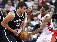 Toronto Raptors forward DeMar DeRozan, right, battles for the ball against Brooklyn Nets forward Kris Humphries, left, during the first half of an NBA basketball game in Toronto, Wednesday, Dec. 12, 2012. (AP Photo/The Canadian Press, Nathan Denette)
