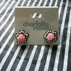 Adorable Pink Rose & Pearl EarringsNWT Stud Earrings are about the size of a dime Shaped like a flower with a pink rose in the middle...surrounded by small faux pearls Gold tone  *New* Charlotte Russe Jewelry Earrings