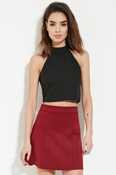 Forever 21 Contemporary - A woven crop top complete with a self-tie halter neckline and a keyhole cutout snap-buttoned back.