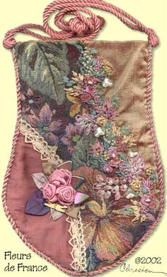 I ❤ ribbon embroidery . . . Fleurs de France Purse- The graceful curves of this purse complement the enchanting arcs of silk ribbon embroidery and ribbonwork rosettes that adorn the curved seams. The embroidery stitches used are woven rose, lazy daisy, French knots and more. The fabrics that you chose for your project can be anything from silk to tapestry.