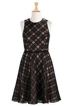 I <3 this Sheer diamond check A-line dress from eShakti  -  black and pale pink windowpane print.   Back zip closure. Round neck. Bra strap keeps. Princess seamed bodice. Piped trim at seamed high waist. Side seam pockets. Knee length. Lined in stretchy crepe. Polyester, textured weave, no stretch, sheer, lightweight. Dry clean. church, going out, cute, want.         lj