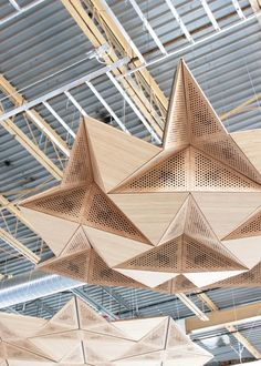an interior architectural paneling system  that uses the techniques of rigid origami to transform the acoustic signature of a space. composed of reflective (solid bamboo inserts),