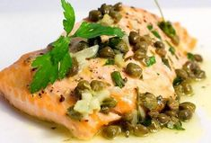 Baked Salmon with Lemon Caper Butter is an easy family dinner! Salmon baked to perfection and topped with decadent lemon caper butter. Fish Dishes, Seafood Dishes, Seafood Recipes, Cooking Recipes, Healthy Recipes, Slow Cooking, Cooking Light, Cooking Time, Easy Family Dinners