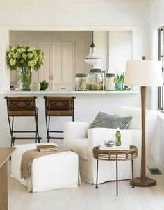 A Holly Hunt Chair And Ottoman Are An Inviting Place To Read In The Sitting  Area Between The Kitchen And Living Room.