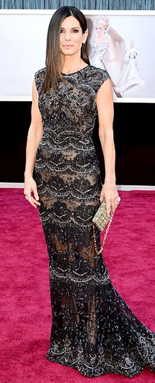 Sandra Bullock at the 2013 Oscars wore  an Elie Saab fully embroided cap sleeve gown with lace panel details.