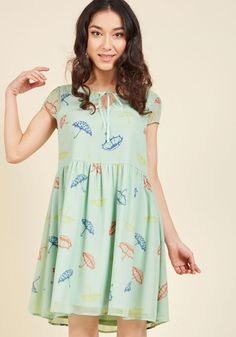 <p>We've taken playful frocks the next level with this mint dress! Part of our ModCloth namesake label, this flowy piece touts sheer, slightly puffed sleeves, a notched neck with ribbon ties, and a colorful umbrella pattern. This bright look sure adds charm to your conviviality!</p>