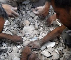Man clears rubble surrounding young girl who was killed during recent Syrian Air force air strike in Azaz.