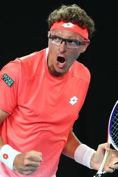 Day 1: Denis Istomin of Uzbekistan celebrates in his first round match against Roger Federer of Switzerland during day one of the 2019 Australian Open at Melbourne Park on January 14, 2019 in Melbourne, Australia.
