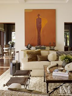 Transitional living room with filled coffee tables and side chairs perfect for house parties.