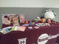 Children's toys and anime books at Japanese movie night reception