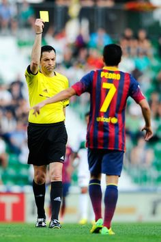 Pedro Rodriguez of FC Barcelona is shown a yellow card by the referee Fernando Teixeira Vitienes during the La Liga match between Elche FC and FC Barcelona at Estadio Manuel Martinez Valero on May 11, 2014 in Elche, Spain.