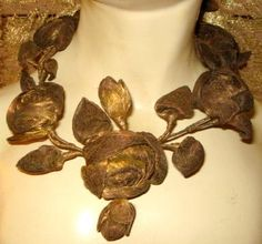 French gold mesh ribbon art…  densely woven gold-lame cloth  plump cabochon roses, layered buds…19th century    Ebay  (sold for almost $400)
