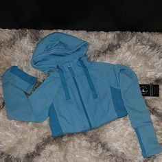 One day sale! Fitted thumbhole hoodie Body of hoodie is made out of 51% cotton & 49% polyester the trim is 57% cotton, 40% polyester & 3% spandex. The tag says it's color turquoise but it really looks like baby blue. Very comfortable! Active life Sweaters