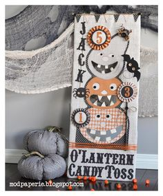 Wowzers!  This is super cute!   DT Thienly has done it again!  Look at her amazing project called JACK O' LANTERN CANDY TOSS!  Using a piece of cardboard covered in burlap and placing these awesome pumpkins with their mouths cutout in the cardboard, you have a game for the kids to play!  You HAVE to check out all the pics on her page and go here for her awesome full instructions to make your own!!!   http://modpaperie.blogspot.com/2013/10/jack-olantern-candy-toss-svg-cuts-dt.html