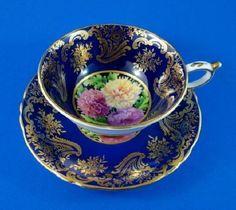 Paragon China teacup & saucer, cobalt blue and gold with chrysanthemums