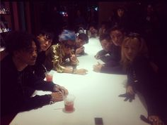 G-Dragon snaps a picture with CL, Taeyang and others