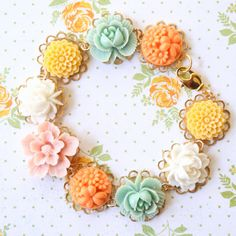 Floral charm Bracelet by NestPrettyThingsShop on Etsy, $36.00  Just beautiful. I want one