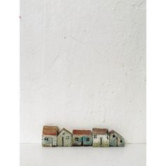 RESERVED Set of 5 miniature ceramic houses made in high fired white... (180 PLN) ❤ liked on Polyvore featuring home, home decor, ceramic home decor, white home accessories, handmade home decor and white home decor