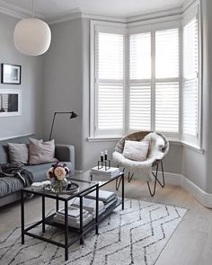 Our living room has a bay window, so balancing light and privacy has always been tricky. Made-to-measure wooden shutters have proved the perfect solution. Bay Window Shutters, Bay Window Decor, Bay Window Living Room, My Living Room, Home And Living, Living Room Decor, Wooden Shutters, Blinds For Bay Windows, Window Seats