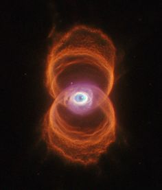 """It's a giant eyeball in space!!! MyCn18 """"Etched Hourglass"""", Hubble telescope data processed by Judy Schmidt, 2013."""