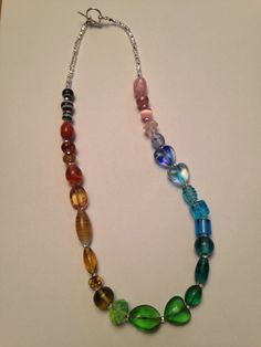 Trio of Hearts Mixed Glass Rainbow Necklace by TripIntoLight