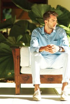 Relaxed look.  White pants and blue stripe dress shirt.
