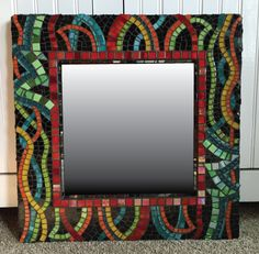 """18"""" x 18"""" mosaic stained glass and tile mirror  Exceptional!  Love the movement and the whimsy."""
