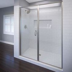"Basco Infinity 58"" x 72.13"" Pivot Frameless Shower Door Trim Finish: Brushed Nickel, Glass Type: Clear"