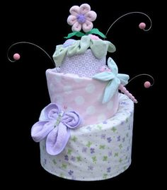Topsy Turvy Diaper cake for a baby girl.