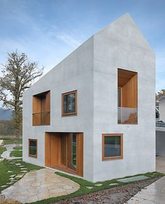 two in one villa: one house for two families, geneva/clavien rossier