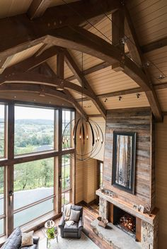 A room with a view in this modern rustic home. #easttennessee #modernrustic #hubbardtonforge #greatroom Architecture by Samsel Architects, Asheville, NC.
