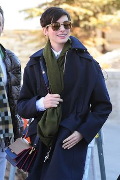 613a29690e84b3 Anne Hathaway perfected the chic but casual look when she arrived at  Sundance Film Festival last week wearing Carrera by Jimmy Choo shades in  Gold Leopard.