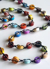 Rolled Paper Bead Necklace  Coy' smom used to sit and make these.....I have some put up for the girls. Guess they are big enough now that I could dig them out for them!
