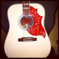 A Rare White Gibson Guitar Hummingbird Acoustic Guitar. Gorgeous. Reminds me of a bandana.