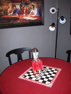 An old checker board makes a perfect center piece for our 50's diner style kitchen. It looks better with the theme if the board is old, but it wouldn't be hard to make a new one look used. And they are very inexpensive.