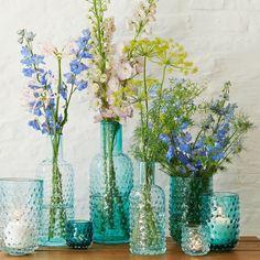 Blue glass vases with springtime florals