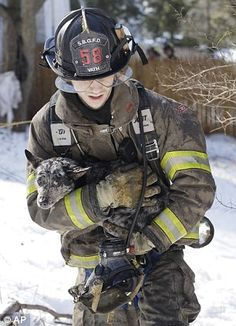 2/13/13 Rescue: Vath clutches the dog tight as he carries it to safety. You're safe now: The heart-melting moment dogs are rescued and are resuscitated by firefighters.