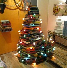 The perfect tree for a classroom! It's not a Christmas Tree.it's not a Holiday Tree.it's a Book Tree! Christmas Tree Made Of Books, Unusual Christmas Trees, Diy Christmas Tree, All Things Christmas, Christmas Holidays, Merry Christmas, Christmas Decorations, Holiday Tree, Holiday Decorating