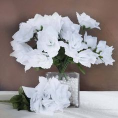 84 Artificial Silk Open Roses Wedding Flower Bouquet Centerpiece Decor - White /  Worried about spending a fortune on real flowers and only using them for one event? Why buy real flowers when you can make your money's worth by spending your money on reusable silk roses?  With our collection of open silk roses, you don't have to worry about any of that. Each of our beautifully crafted open silk roses is bloomed in perfection, supported by stems, and surrounded by vibrant green leaves. These…
