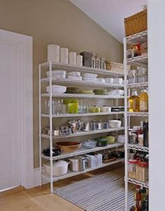 I am working on reorganizing my pantry and laundry room.  I love this idea~