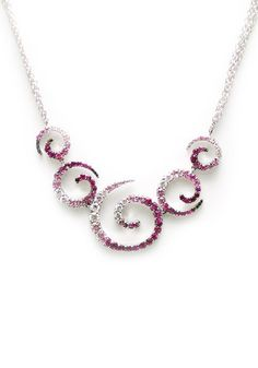 """This beautiful necklace from the """"Zingara"""" collection by Stefan Hafner features wonderful variagated color in an elegant scroll design. Set with 2.02ctw pink sapphires and .59ctw white diamonds, the n"""
