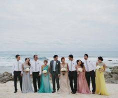 The bridal party dressed in long gowns in different hues, while the groomsmen wore crisp white shirts and gray ties without jackets.