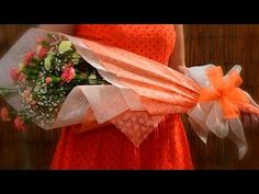 How to make a bow with multiple loops.  The video is near the bottom of the page and it first demonstrates wrapping the flowers with tissue paper.