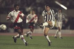 Zinedine Zidane of Juventus (right) kicks to goal