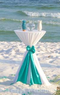 Barefoot Weddings® / Instead of unity candles, bride and groom each has a glass vase full of colored sand that they pour into glass jar