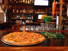 "Stone L'oven Pizza Company in Falmouth Village is offering: ""St.Patty's"" Pizza special: • Garlic infused oil • Our spinach and artichoke dip as base • Roasted Chicken • Red onions • Chipotle Tomatoes • Mozzarella pizza cheese  ""Leprechaun"" Drink Special • Vodka • Peach Snapps • Blue Curaçao • Orange juice  Is anyone else hungry?!"
