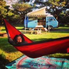 Our favorite living room: 82 VW Westy + Transawn 2000 + picnic table + Eno Hammock + $10 Outdoor Rug.