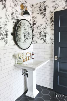 """Full Bloom Just because it's a half bath doesn't mean it can't be full of style. Small in square footage but big in personality, powder rooms are the perfect forum to express your individuality and design philosophy—after all, you've got a captive audience. One way to make an impression? Let a unique wallpaper guide the overall concept, as designer Shea McGee did in this Salt Lake City powder room. """"I fell in love with the vintage vibe of this rose print, which inspired the classic feel of…"""