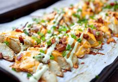 Loaded Potato Wedges - These wedges are potato perfection! Baked until crispy and topped with cheddar, bacon, chives, and an avocado sour cream sauce. These just might be potato perfection! Loaded Potato, Loaded Baked Potatoes, Appetizer Recipes, Appetizers, Dinner Recipes, Wedges Recipe, Potato Wedges Baked, Sour Cream Sauce, Main Meals